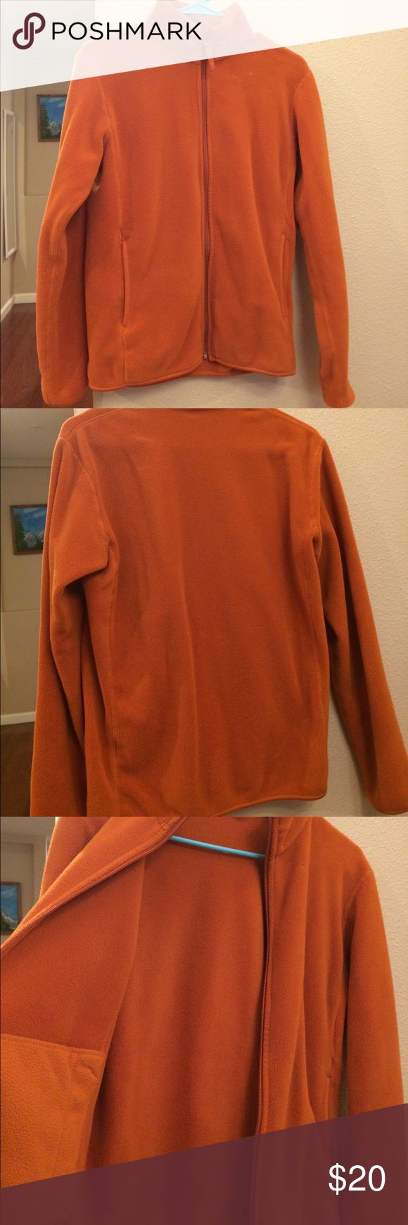 Uniqlo Orange Fleece Jacket Sz XS Gently used. Good condition- clean/ no stains. Soft and warm! Has two side pockets on outside and two pockets on inside. Color is a burnt orange. No trades. Uniqlo Jackets & Coats