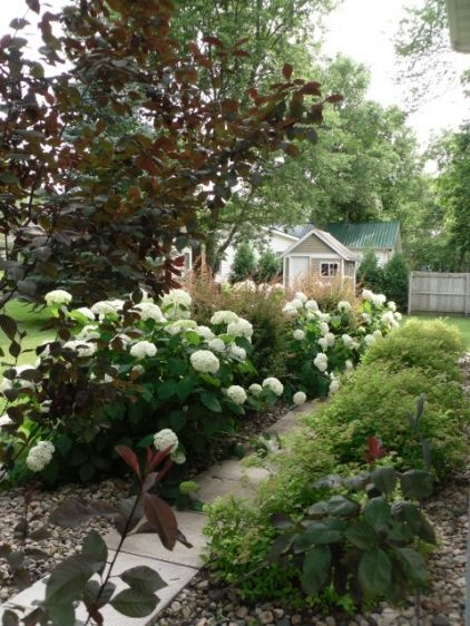 Hydrangeas are perfect in formal gardens but work just as well in more informal settings. A path lined with these beauties is the perfect sidewalk guide for nighttime strolls.: White Gardens, All White, Eclectic Patio, Lakeview Drive, Second Story Deck, Photo, Light