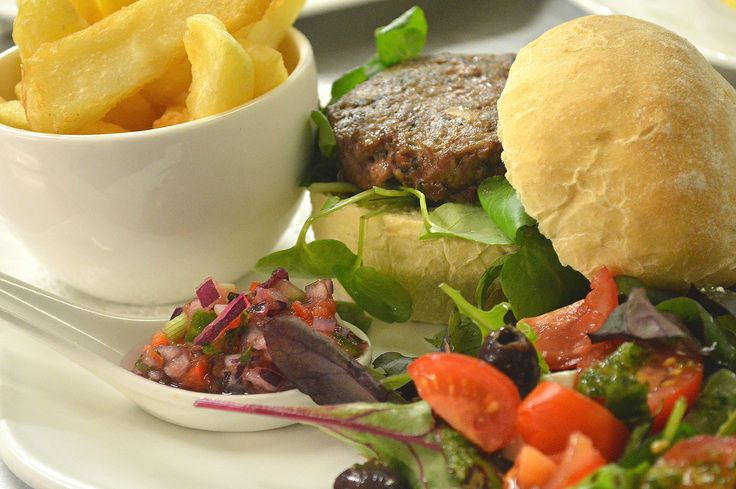 Welsh lamb and garden mint burger, cherry tomato, feta and olive salad, chilli and tomato salsa, triple cooked chips. Milebrook House Hotel and Restaurant near Knighton on the borders of Powys, Shropshire and Herefordshire.