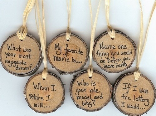 Dream Green Weddings: Want to get your guests talking at your eco friendly wedding, outdoor celebration or nature-themed event? These unique and natural rustic wooden conversation starters will be the talk of your reception! Made from reclaimed cherry tree branches, these handmade charms have been sanded smooth and finished with a light coat of pure beeswax and carnauba wax blended with natural orange oil. A single hole has been drilled at the top and natural hemp twine completes the look…