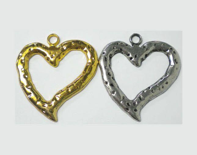 Μεταλλική καρδιά σφυρίλατη για μπομπονιέρα γάμου