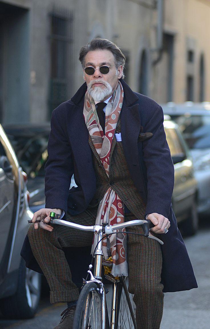 Italian stylish man on bycicle #fashion #style
