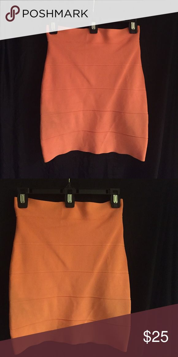 BCBG Maxazria Power Skirt.  Coral color. The Power skirt is a must have! For work or play!  Fabrication 90% Rayon, 9% Nylon, and 1% Spandex.  Machine wash cold! BCBGMaxAzria Skirts Mini