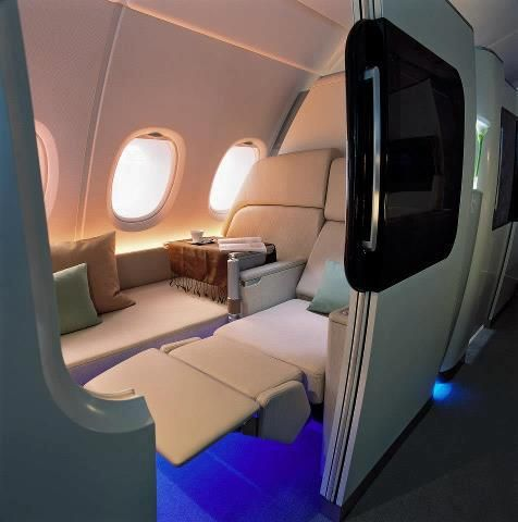 Qantas New First class on Airbus A380. The interior, designed by Marc Newson includes LCD touch panels, leather seating, plants, sheepskin-covered full-length beds and more than 1,000 videos to choose from.
