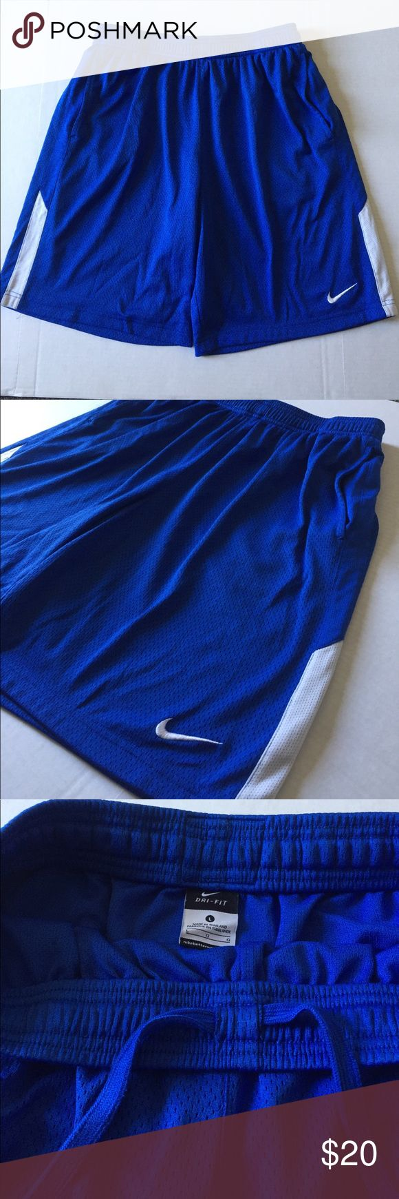 Nike Men's Dri-Fit Athletic Shorts Nike Men's Dri-Fit Athletic Shorts.  Excellent condition!  Royal blue color.  Size Large.  Side pockets.  Drawstring waist.  100% polyester.  Double layer of mesh material. Nike Shorts Athletic