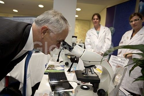 Australian Prime Minister, Malcolm Turnbull. Australian Prime Minister, The Honourable Malcolm Turnbull looking through microscope at Research Week event.Photograph By Noel   Fisher #PeoplePhotography