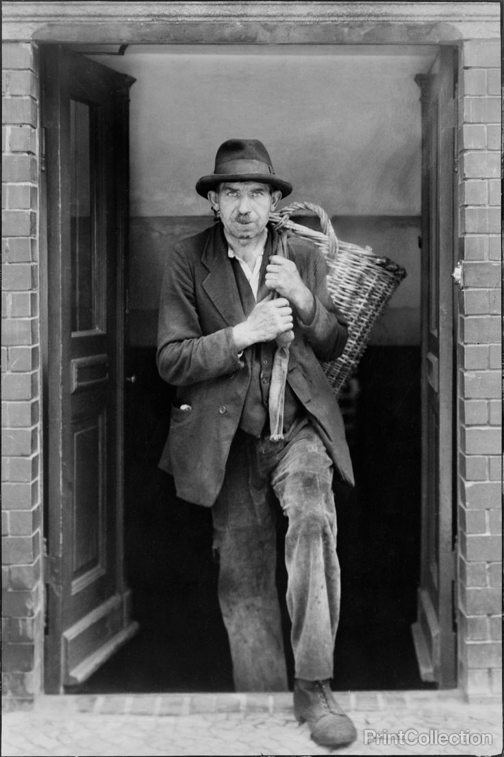 Photographed by August Sander in 1929.åÊPhotograph shows coal deliveryman, emerging from door of cellar, with empty coal basket, Berlin, Germany. Notes:Part of: Menschen des 20. Jahrhunderts.åÊSigned