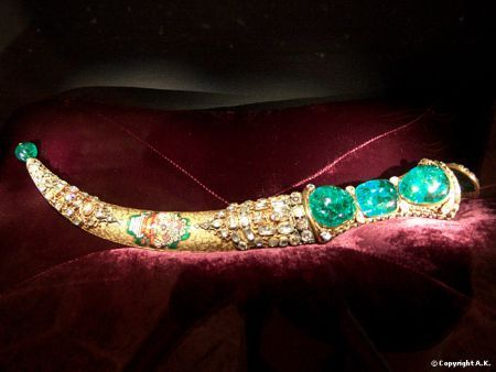 The Topkapi Emerald Dagger is the renowned jewel-studded dagger of mid-18th century origin, preserved and displayed for public viewing at the treasury of the Topkapi Palace Museum, in Istanbul, Turkey. One side of the handle of the dagger is set with three large Colombian emeralds of good color and clarity