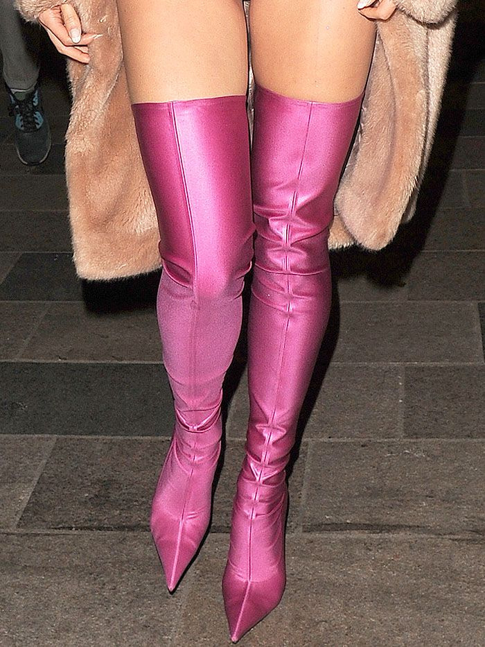"Pixie Lott wearing a pink superhero-inspired outfit with pink Balenciaga spandex thigh-high boots for a secret gig as part of the ""Sink The Pink"" club night at The Clapham Grand in London, England, on April 14, 2017."