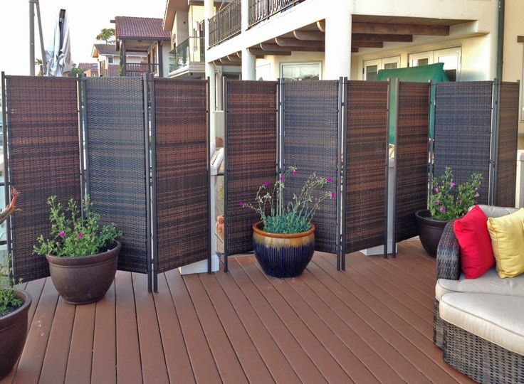 Versare 3-Panel Wicker Partitions are used to divide space and enhance this beautiful outdoor arrangement.