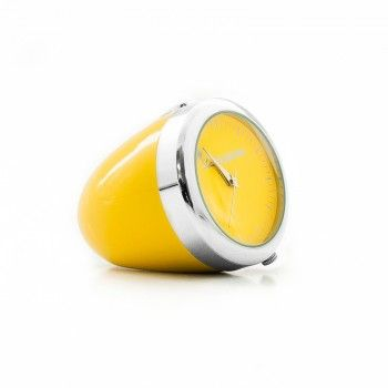 """Small table clock inspired to the design of the headlight used in the """"125"""" Vespa. Color yellow. Packaged in boardcard box of cm 10 x 9,8 x 4,5."""