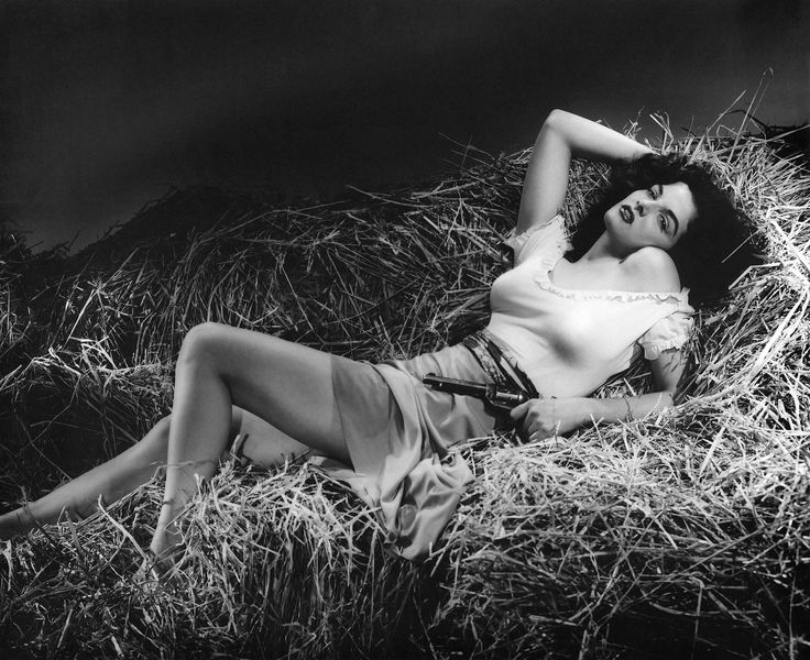 #actress #black and white #celebrity #cinema #diva #famous #film #gun #hollywood #jane russell #monochrome #motion pictures #movie #person #portrait #publicity #revolver #star #the outlaw #woman