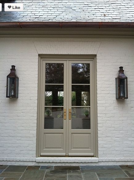 Door Is painted in Texas Leather AC-3-Benjamin Moore.  Gorgeous exterior trim color.
