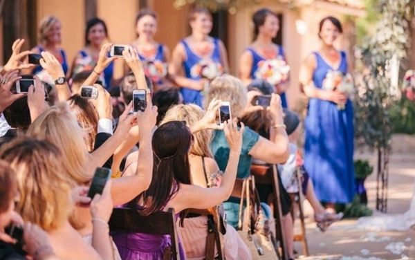 Unplugged wedding - don't let cameras, phones and tablets ruin your photographer's shot and ask your guests to be 100% present at the ceremony | Destination weddings