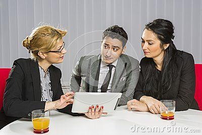 Three business people discussing and planning together during a meeting in office.
