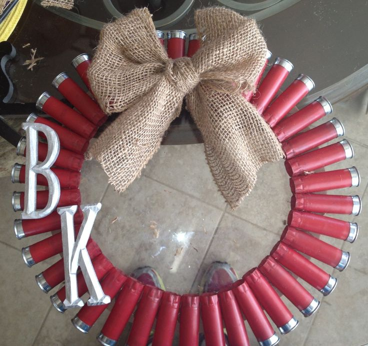 Shot gun shell wreath. Made it for my dads man cave. Added a burlap bow and his initials for detail.
