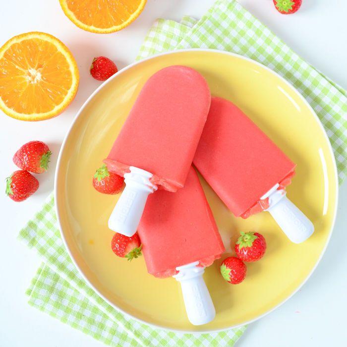 Ik maak graag zelf mijn ijsjes, deze aardbei sinaasappel ijsjes behoren tot mijn favorieten en je hebt ze zo gemaakt!