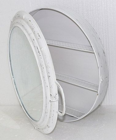 Picked up the silver version of this for our medicine cabinet in the wet bath. I think I'll actually chrome it instead of using the distressed look it comes in, but we'll see. Not bad for $35! :) -Meg  Look at this #zulilyfind! White Metal Porthole Mirror Cabinet #zulilyfinds