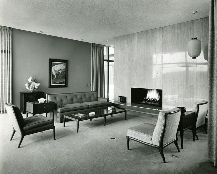 Midcentury Living Room With Minimalist Fireplace