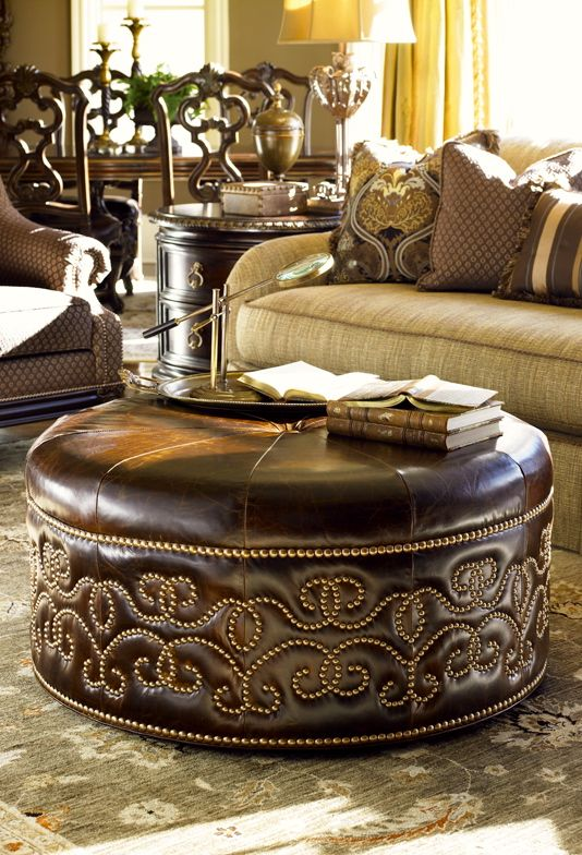 Leather decorative footstool doubling as a livingroom table.   Lexington Florentine collection. The Marge Carson feel to this collection.