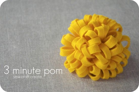 3 minute pompom made with two pieces of felt, a headband, and hot glue. Inexpensive and cute. Could also be made smaller and put on clips for hair or shoes.