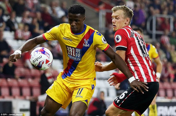 Crystal Palace winger Wilfried Zaha (left) shields the ball from Southampton forward James Ward-Prowse