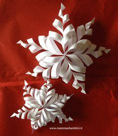 Come realizzare fiocco di neve 3D di carta: servono per ogni singolo fiocco sei fogli quadrati; semplice e molto decorativo!