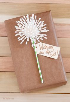 Use q-tips and a fun straw to make your own DIY Dandelion Gift Wrap! This is perfect for birthday presents or graduation gifts.