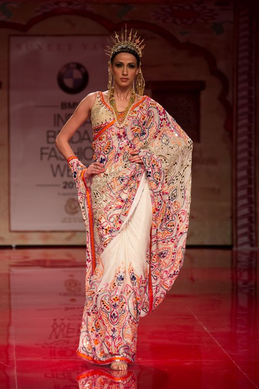 White and multi-colored saree by Suneet Varma. More here: http://www.indianweddingsite.com/bmw-india-bridal-fashion-week-ibfw-2014-suneet-varma/