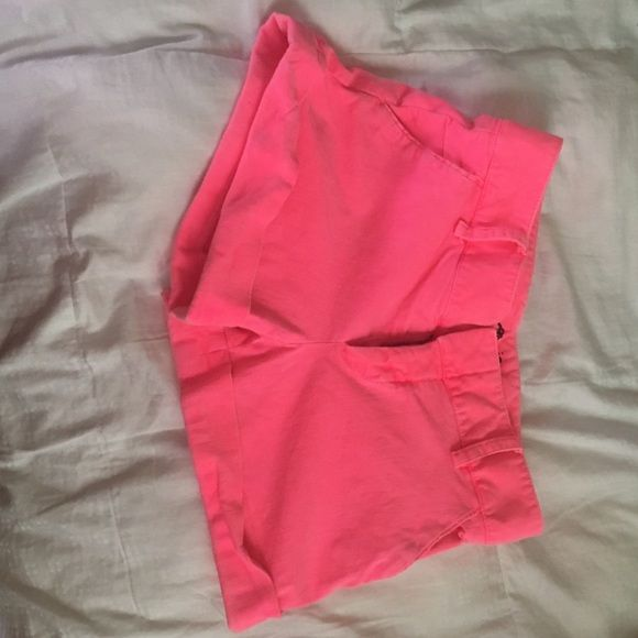 Neon pink shorts Back pockets are fake, worn a few times however they're getting too tight for me now, the folded part is stitched that way, but I love these shorts because they can give you a pop of color with a simple outfit Alice + Olivia Shorts