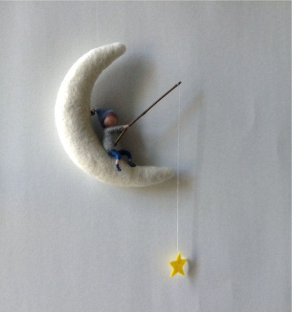 A little needle felted pixie fishing on on the moon. The pixie is made of 100%merinowool. The moon is also needle felted and made of natural wool.
