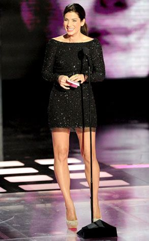 Mini Magic from Sandra Bullock's Best Looks At the MTV Movie Awards, Bullock sparkles in a black cowl-back long-sleeved mini by Oday Shakar and beige Louboutin pumps as she accepts her Generation Award. Way to look the part, Sandy!
