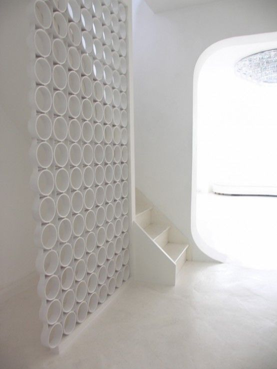Amazing Futuristic Interior That Gives Some Ideas For Decorating In This Style : Futuristic Interior With White Walls Wooden Stairs Ceramic Floor Big Circle Chandelier Sofa