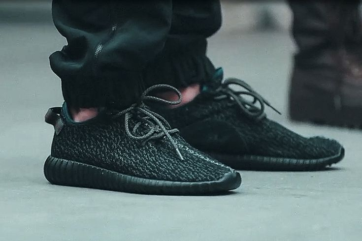 A preview of the adidas Originals Yeezy Boost Low in Black is showcased. Stay tuned in to KicksOnFire for more information on its official release.