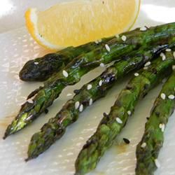 Asparagus spears are marinated in hoisin sauce, then grilled to smoky perfection and sprinkled with sesame seeds for an Asian-inspired side dish.