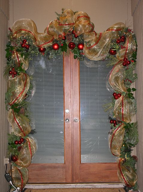 "Front Door Garland using 21"" Deco Mesh and wired ribbon and tucking in some fresh greenery by sylharden, via Flickr"