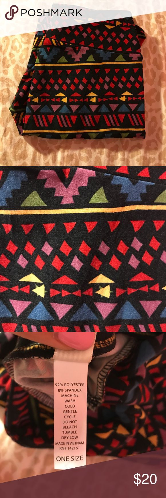 New LuLaRoe Tribal Print Leggings Brand new never worn school supply leggings. LuLaRoe doesn't put tags on their leggings. They are black with red, blue, purple, and green details.  I am offering the for $20 to make up for shipping cost. LuLaRoe Pants Leggings