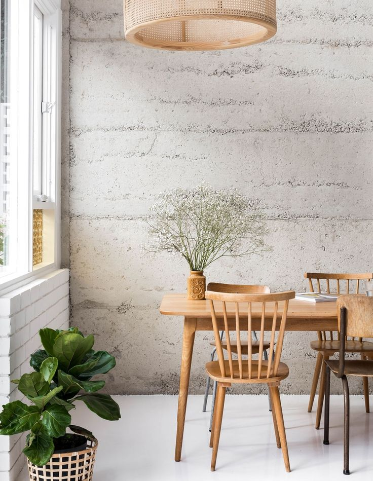 Rammed recycled concrete rubble wall and white resin floor