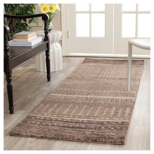 """• 100% polypropylene<br>• No backing<br>• Contemporary pattern<br>• Machine loomed<br>• Medium pile; .5-1""""<br>• Vacuum regularly; use rug pad<br><br>Add a rustic yet modern vibe to your décor with the Safavieh Tunisia Rug. The unique pattern and durable construction will add lasting style to any room.  This rug has a comfortable medium pile and is perfect for a high foot traffic area...."""