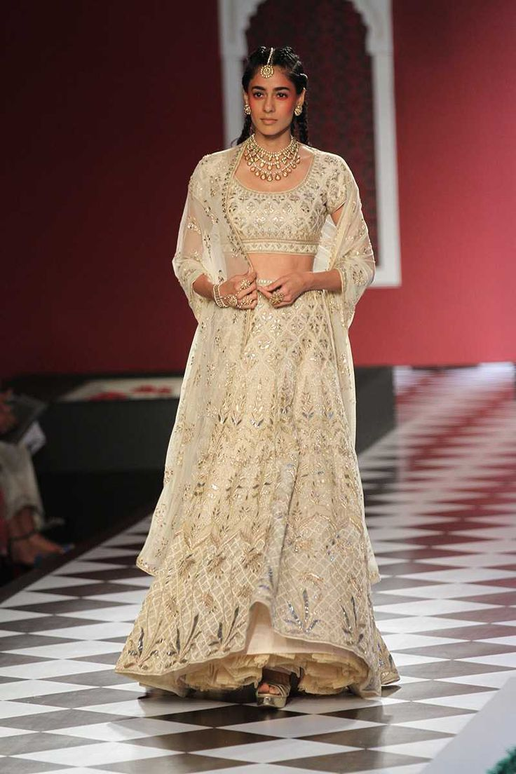 A gorgeous ivory white bridal lehenga from the collection epic love by anita dongre #frugal2fab