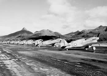 This is an image of Canadian fighter jets during World War II. This source is credible as it is an image taken of Royal Canadian Air Force jets lined up for action. This tells us about the changing lives of Canadians at the time because by the end of the war, the Royal Canadian Air Force had grown to be the fourth largest allied air force in the world. Canada had created a formidable air force after a time of depression and economic struggle.