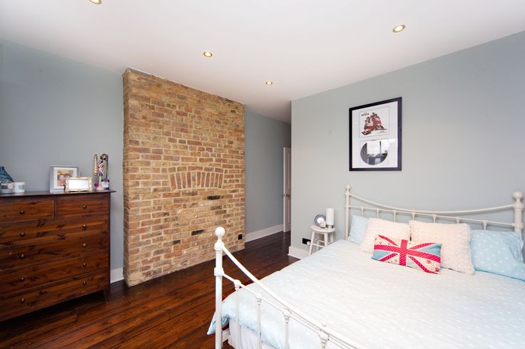 This guest bedroom is painted in Farrow & Ball Light Blue