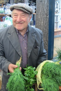 Charming herb vendor sells wonderfully-scented mint & dill in Kraków