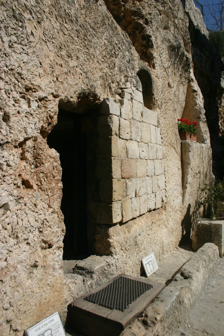 The Garden tomb, Jerusalem, Israel., and a stone was rolled across the entrance and guarded by Roman soldiers. The track remains that held the stone in place!