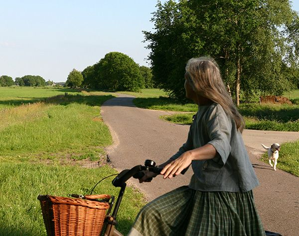 Me riding my bike with the dogs. Wearing a tunic by 13threads