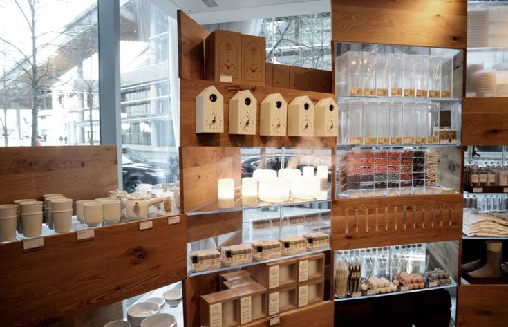 "Muji's simple and user-friendly products range in size (from pens to the ever-popular bean bag chairs) to fit in with the ""Small to Large"" theme of the exhibit. Here, the items are featured on Kengo Kuma shelves. 
