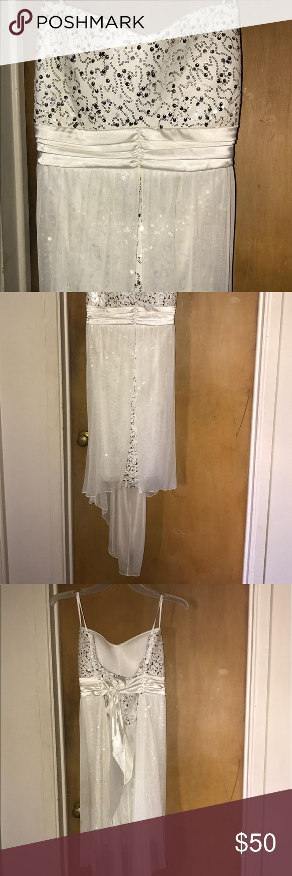 White party dress from Deb Shops White with sequins on the inside and mesh, flowy material on the outside, low in the front and long in the back!! deb shops Dresses High Low