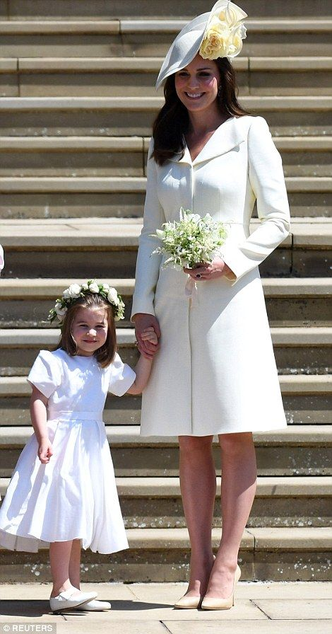 Princess Charlotte holds her mother's hand...