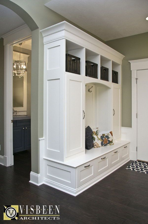 Love this mudroom area! This mudroom behind the front door with built ins to put your shoes and other stuff in is really worthy to have. Also love the color palette.