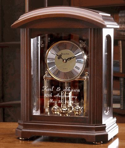 """They will cherish this personalized solid wood Bulova Nordale clock forever. it is 11.5"""" tall, 8.24"""" wide and 5"""" deep, features a glass front and sides, and is housed within a walnut case. Clocks of this quality become family heirlooms. Also makes a perfect retirement clock or corporate gift."""